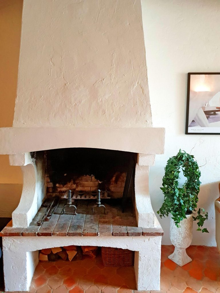 village in vence with fire place and white painted walls