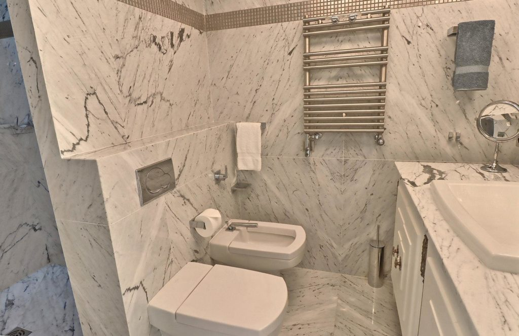marble design bathroom with silver accents