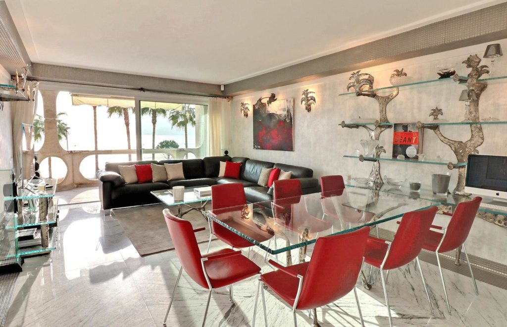 living room of apartment on cannes croisette with red accented design