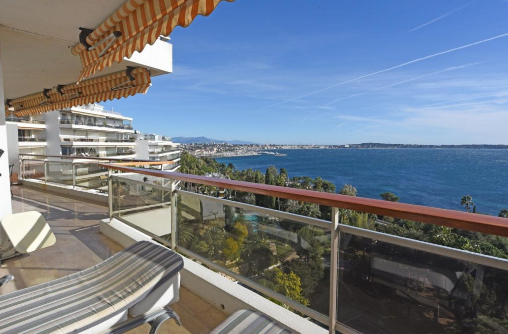 blue ocean view from balcony of apartment in cannes