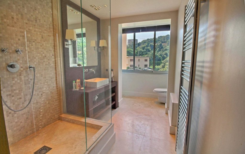 open bathroom with tile floors and standing shower