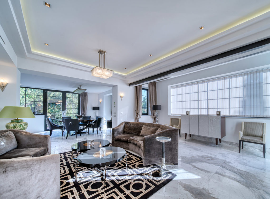 living room of villa with luxury feel and design printed carpet rug large windows