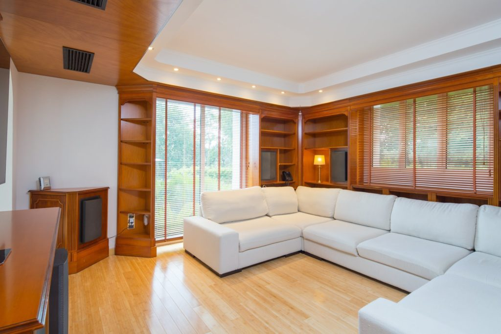 living room of villa with private pool in south france with white couch and wood floors