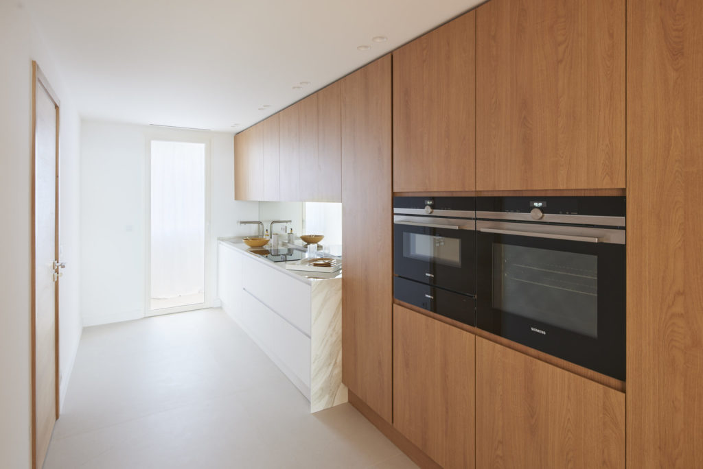 kitchen with wooden cabinets and white counters