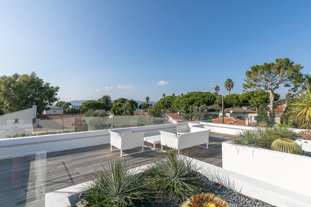 rooftop terrace with minimalistic white furniture and panoramic view