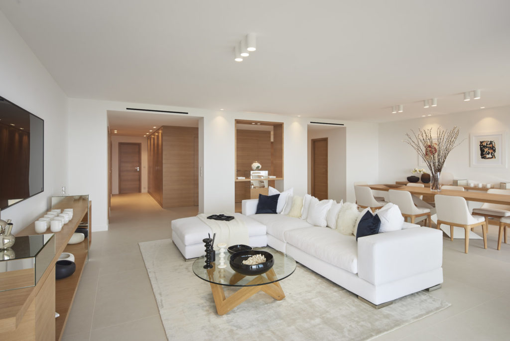 luxury living room in cannes with white couch and grey rug chic design