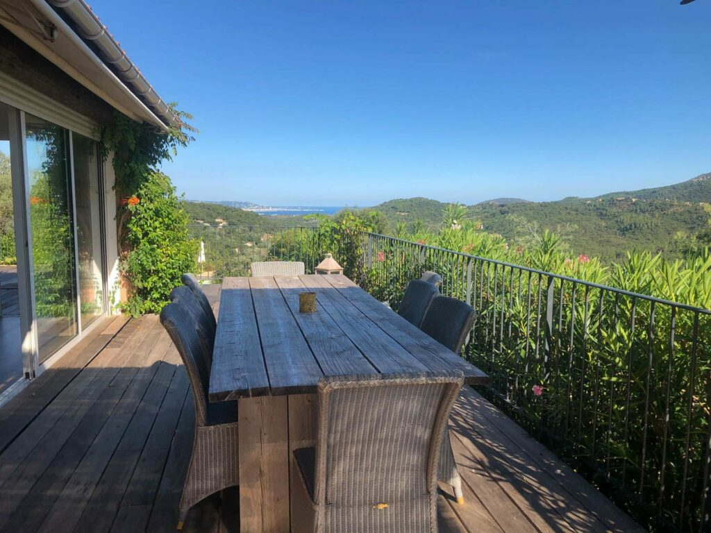 outdoor large long wooden table with beautiful view of the mountains