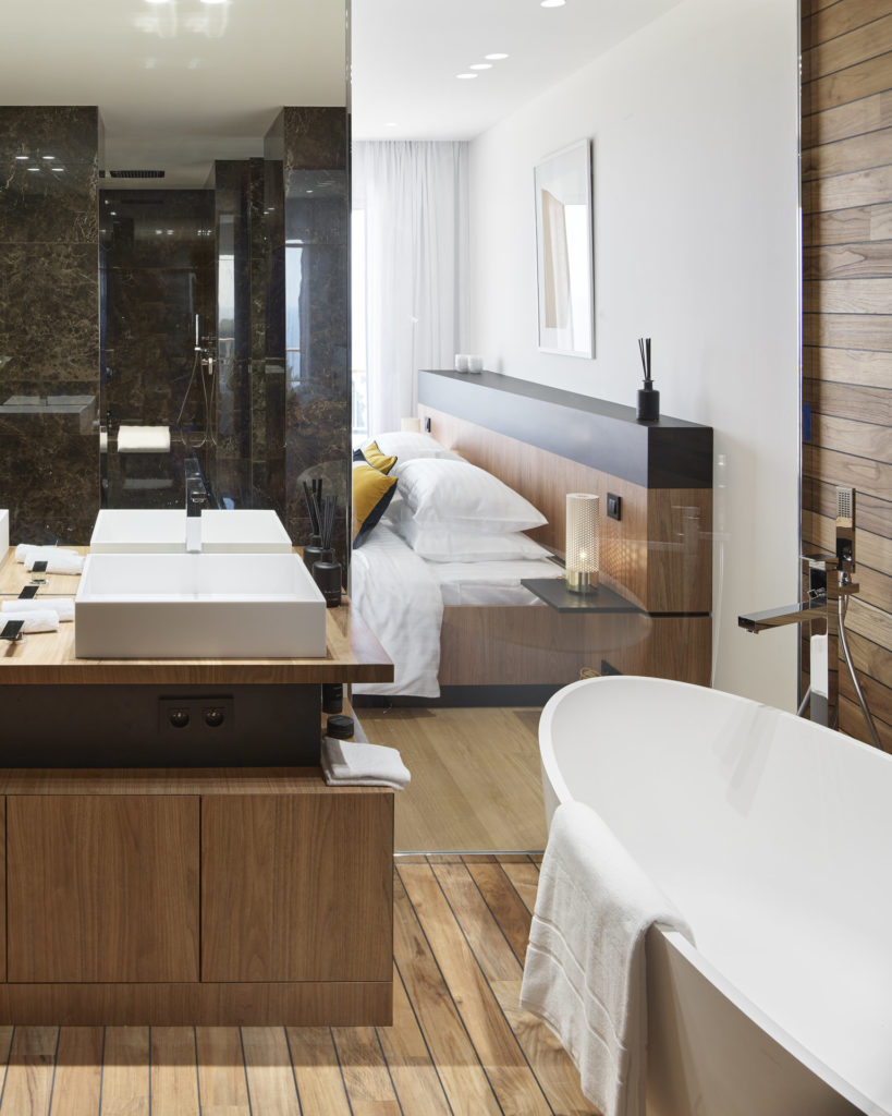 luxury bathroom property in cannes with large white bathtub white wood walls and floors