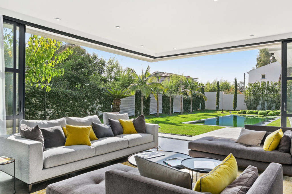 open couch area luxury property south france with grey couch and blue and green pillows