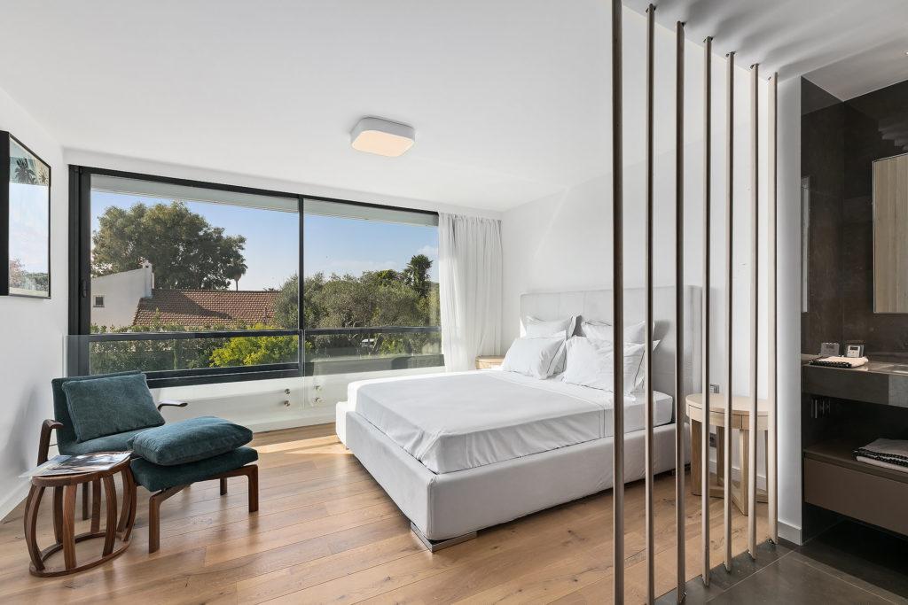 modern bedroom with large rectangular window