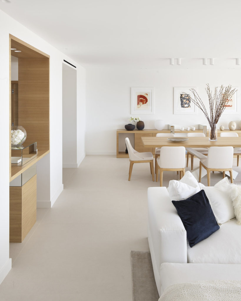 modern luxury apartment in cannes with white walls and light wood accents