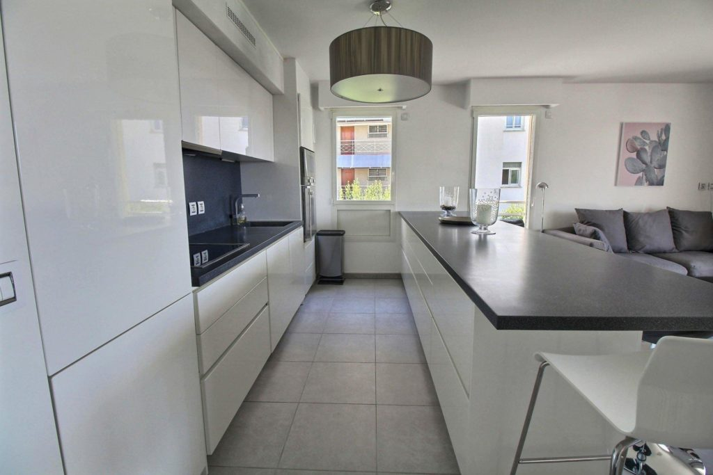 modern kitchen in cannes apartment californie with modern appliances and white cabinets
