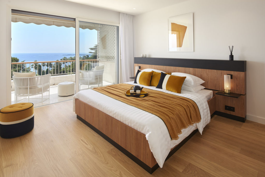 bedroom of luxury apartment in cannes with access to terrace sea view
