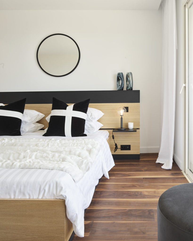 bedroom of luxury cannes apartment with wood floors