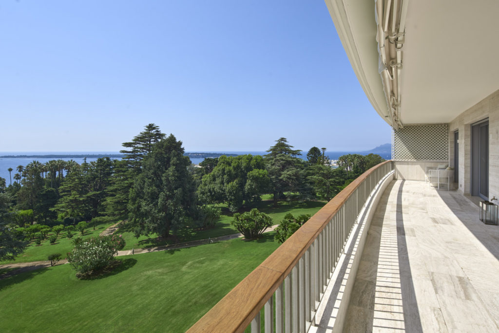 terrace view of large plot of green land with garden trees in south france