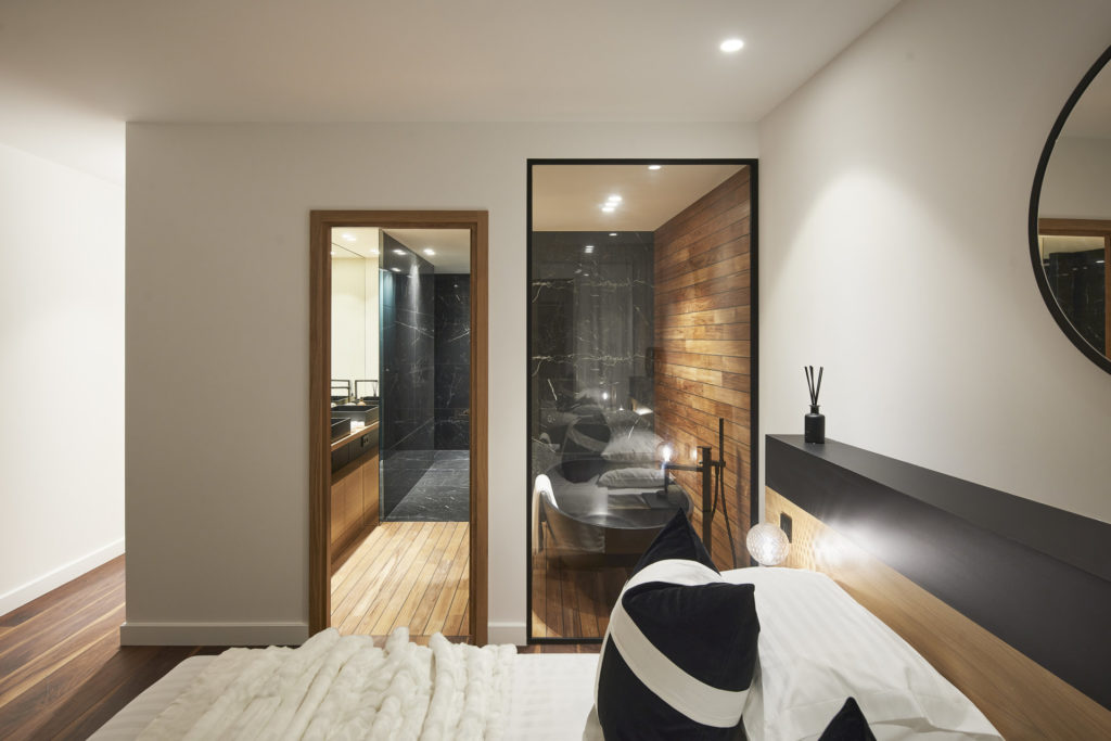 luxurious bedroom with view of beautiful modern bathroom