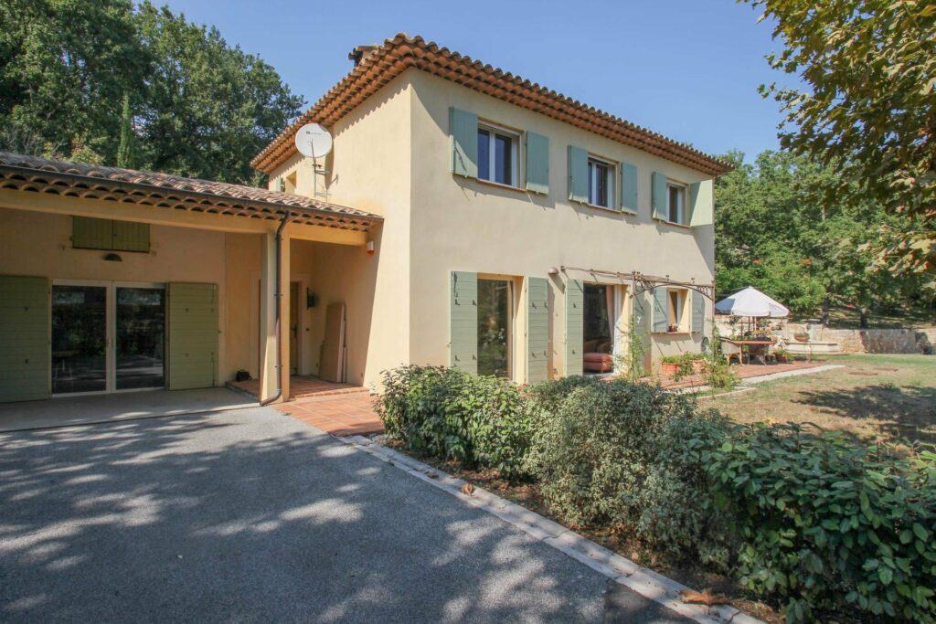provencal style villa with two floors and blue shutters garden south france