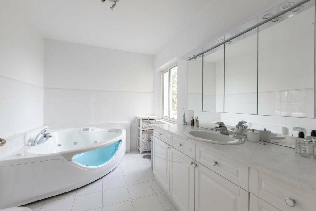 white modern bathroom at luxury villa in cannes with white ceramic bathtub