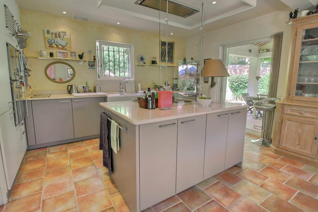 kitchen with cool tone and white cabinets center island