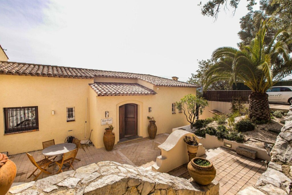 exterior of luxury property in cannes with provencal style and warm colored stone floors