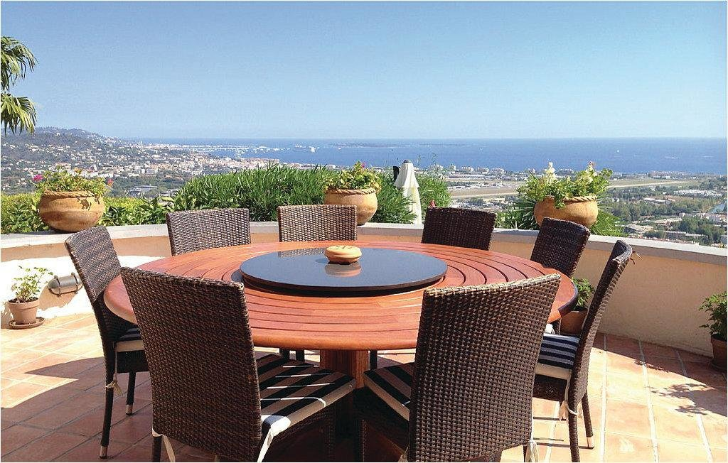 outdoor round wooden table with a sea view