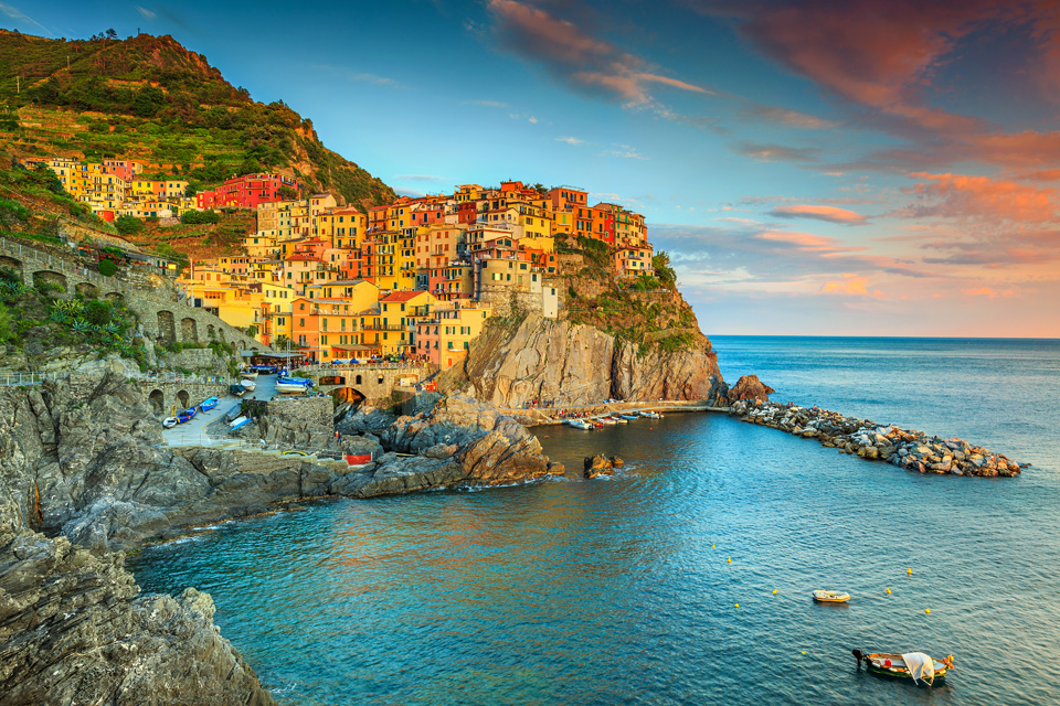 Picture of Manarola touristic village in Cinque Terre National Park, Liguria, Italy, Europe. Cliffside view of ocean and colorful houses all along the coast.