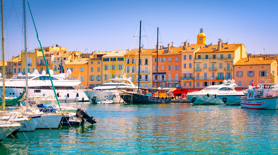 Waterfront and harbor view of St Tropez with luxury boats and yachts.
