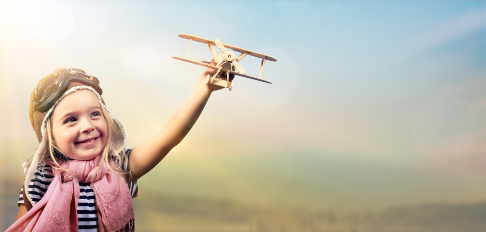 Joyful Girl Playing With Airplane Against The Sky