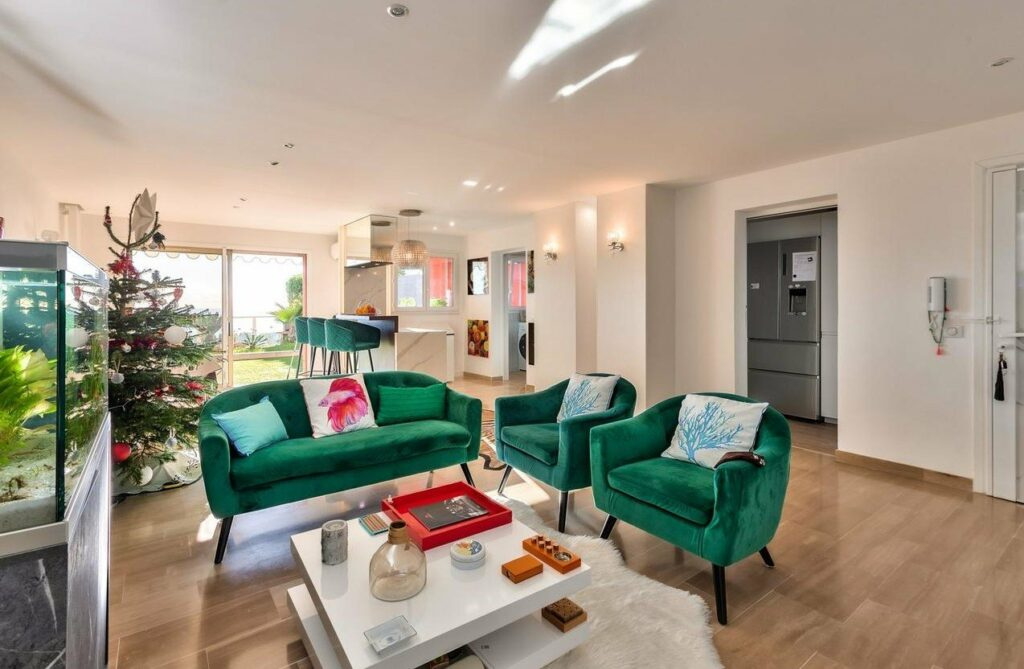 modern apartment in south france sale with green velvet couch and center white table