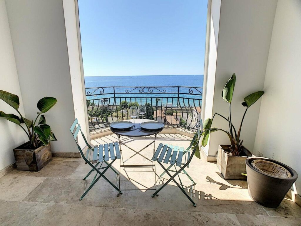 terrace of apartment in cannes with view of blue sea