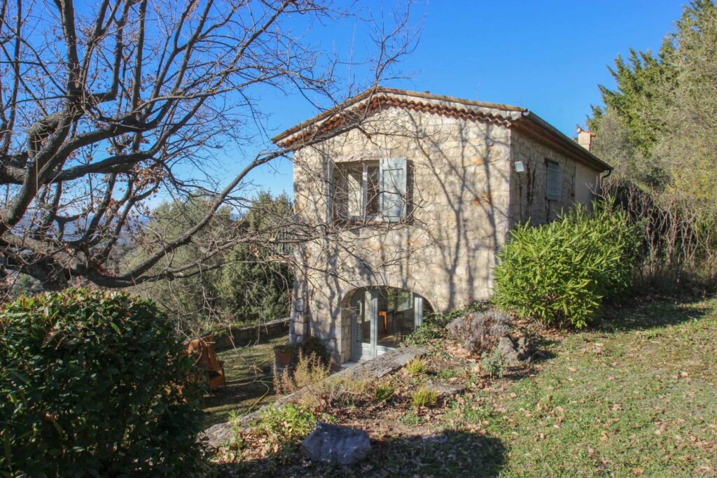 provencal style villa with wooded trees