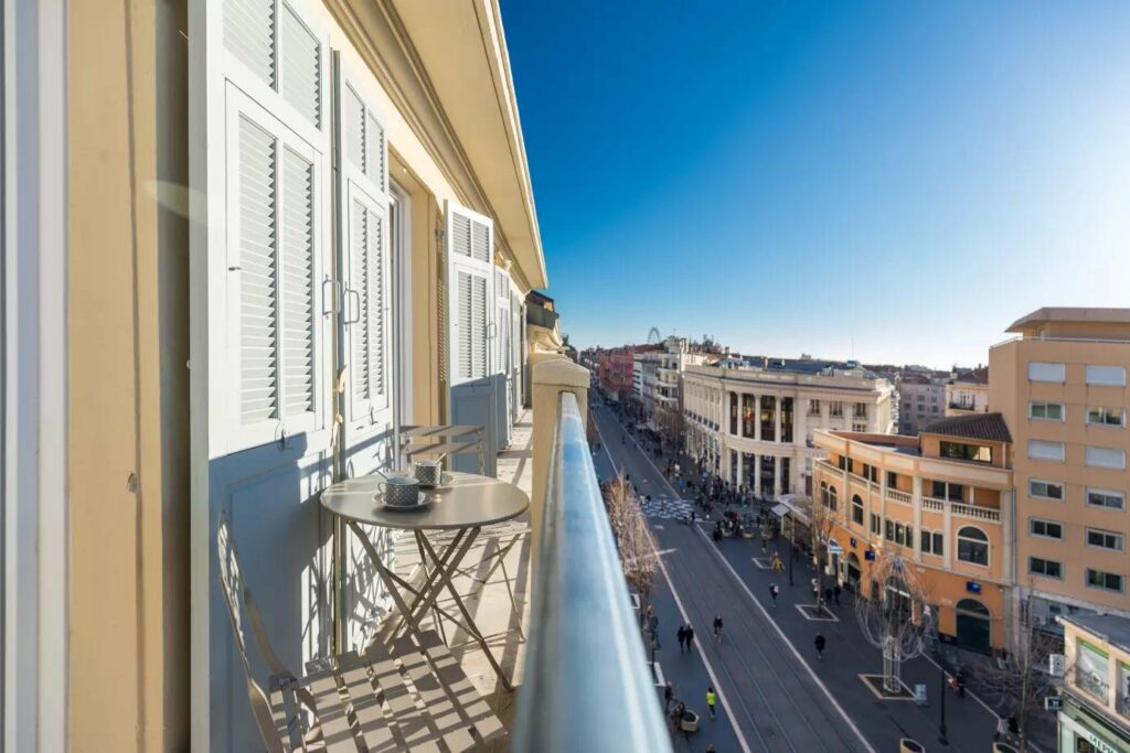 terrace of apartment in central nice with view of main street in south of france