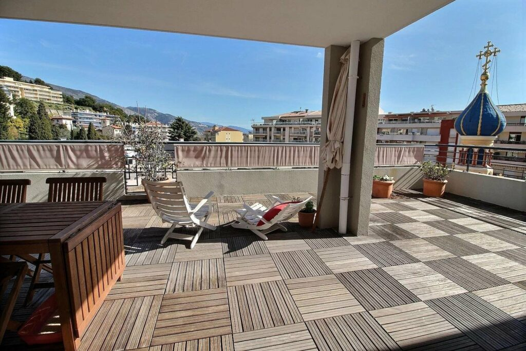 terrace of apartment in menton with view of town in south of france