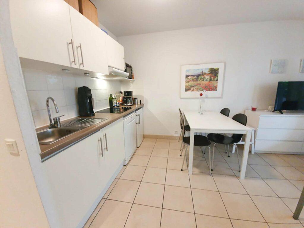 kitchen with tile floors of studio apartment