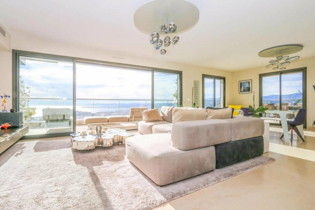 living room with chic design and large terrace with sea view