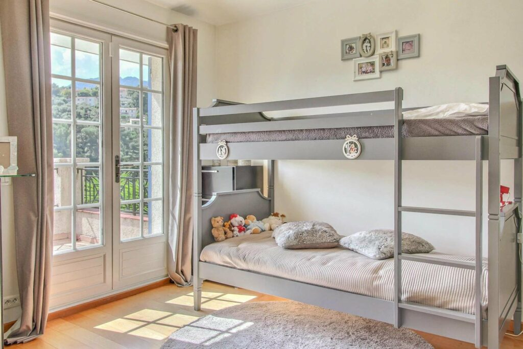 grey bunk bed room in property in south france