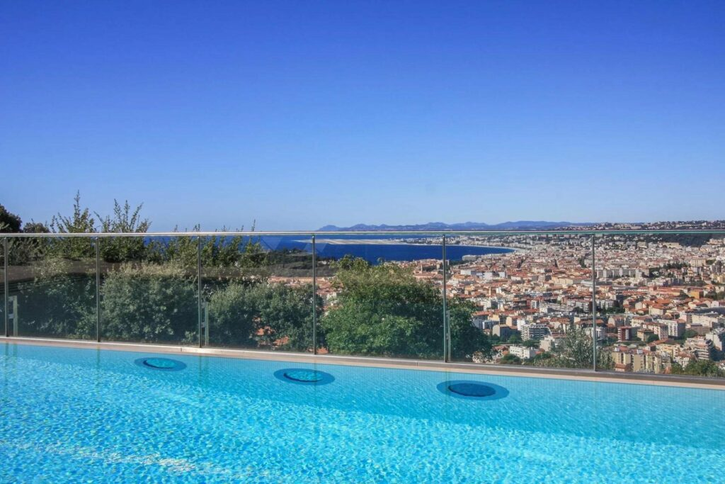 infinity pool at penthouse for sale in south france with city view
