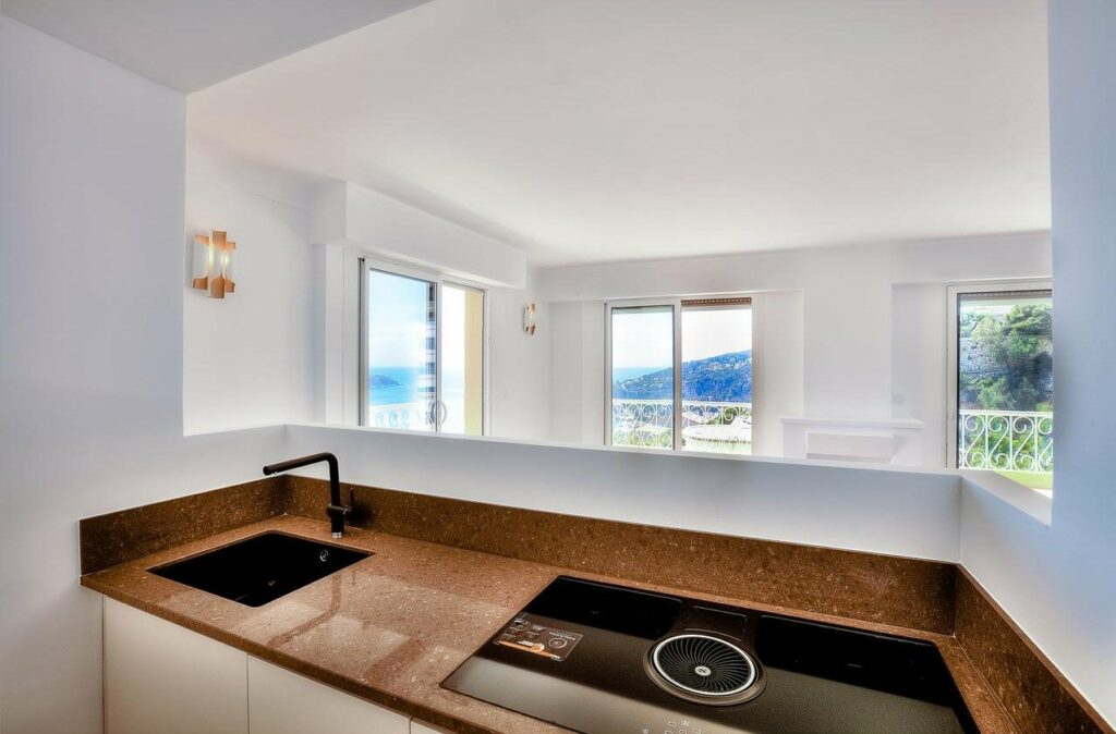 light wooden kitchen countertop with matte black sink in apartment in villefranche for sale