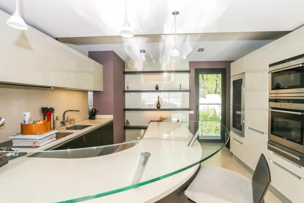 modern design kitchen with glass counter top and shelving