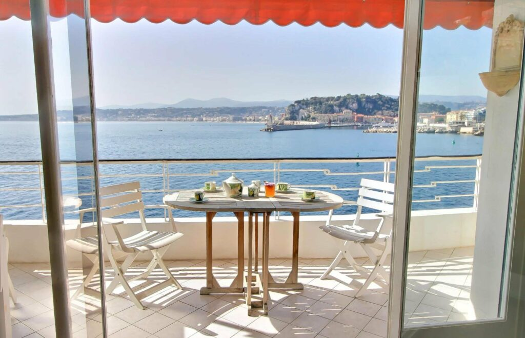 terrace with table facing the mediterranean sea and coast of south of france