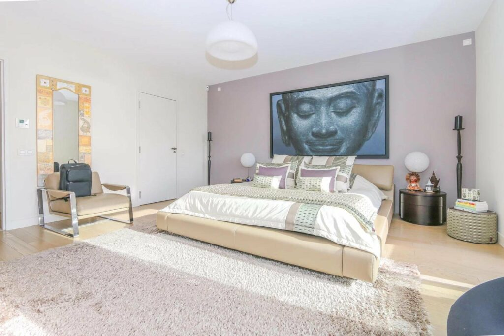 modern bedroom with purple walls and large painting