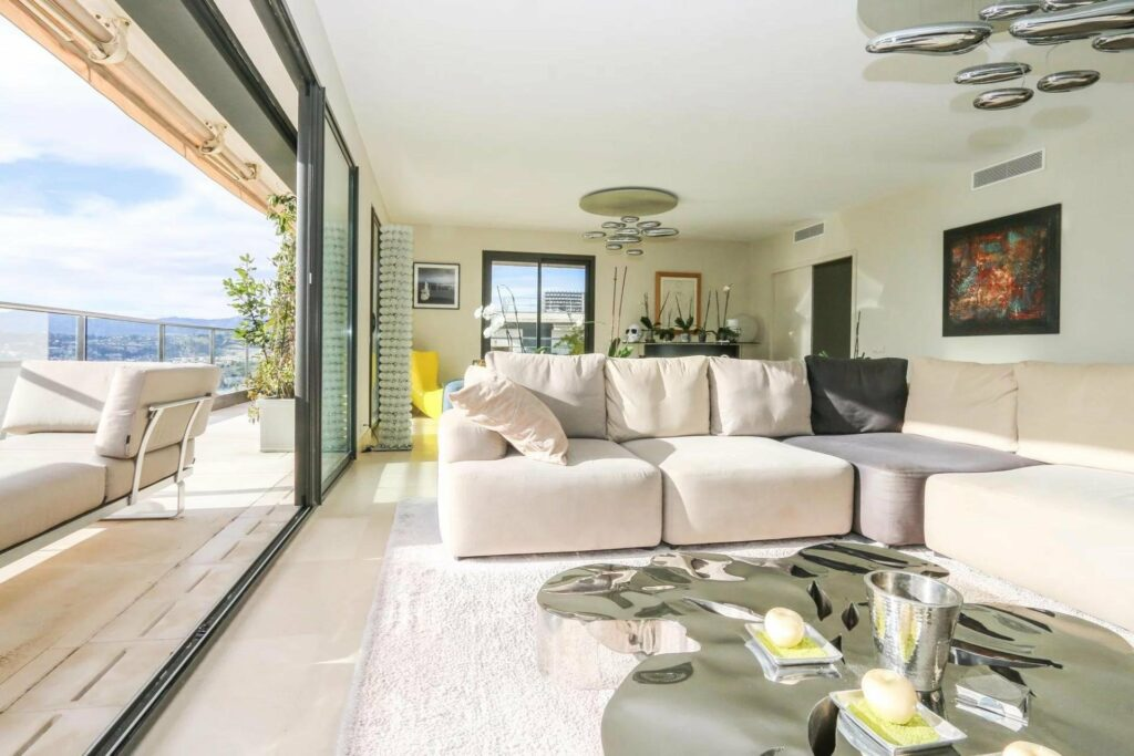 living room with light couch at luxury penthouse in nice mont-boron