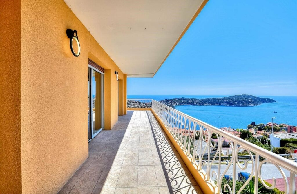 terrace of apartment with yellow walls and view of the mediterranean sea and south france coast