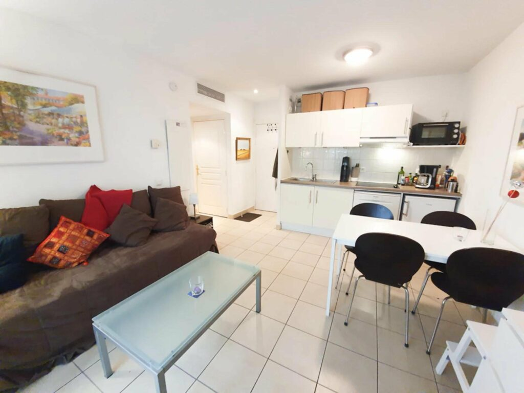 interior of apartment in cagnes sur mer with tile floors and small couch
