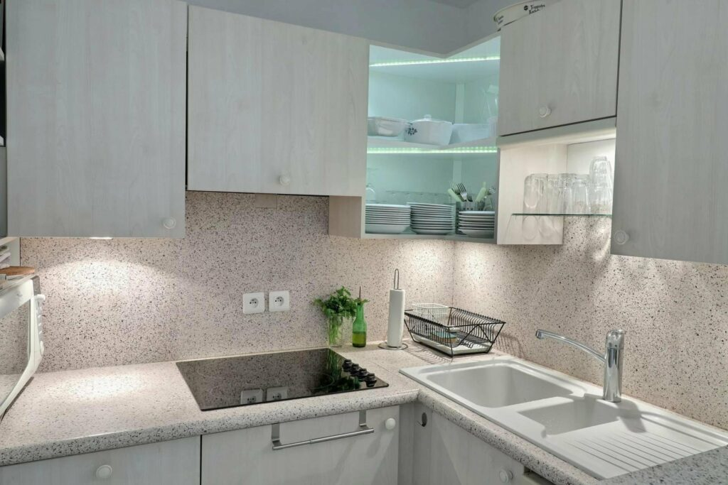 white bright kitchen with white cabinets and plant in south of france apartments