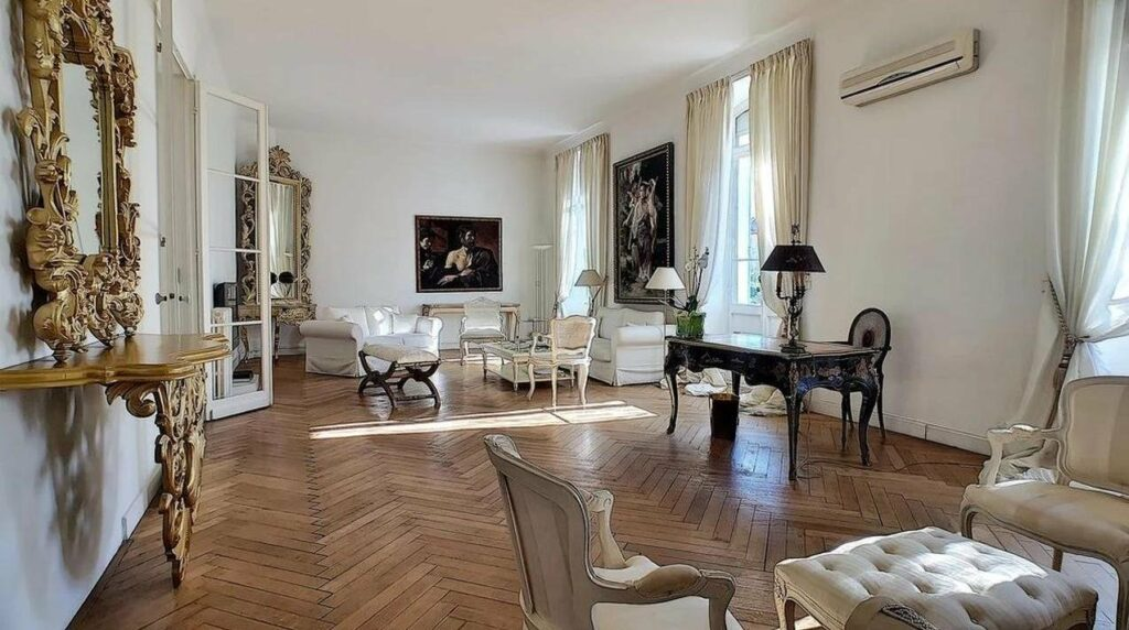french style apartment with light wood floors and classical fixtures and furniture