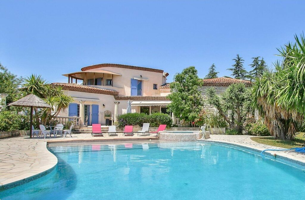 provencal style villa with large pool and tree filled garden in south france