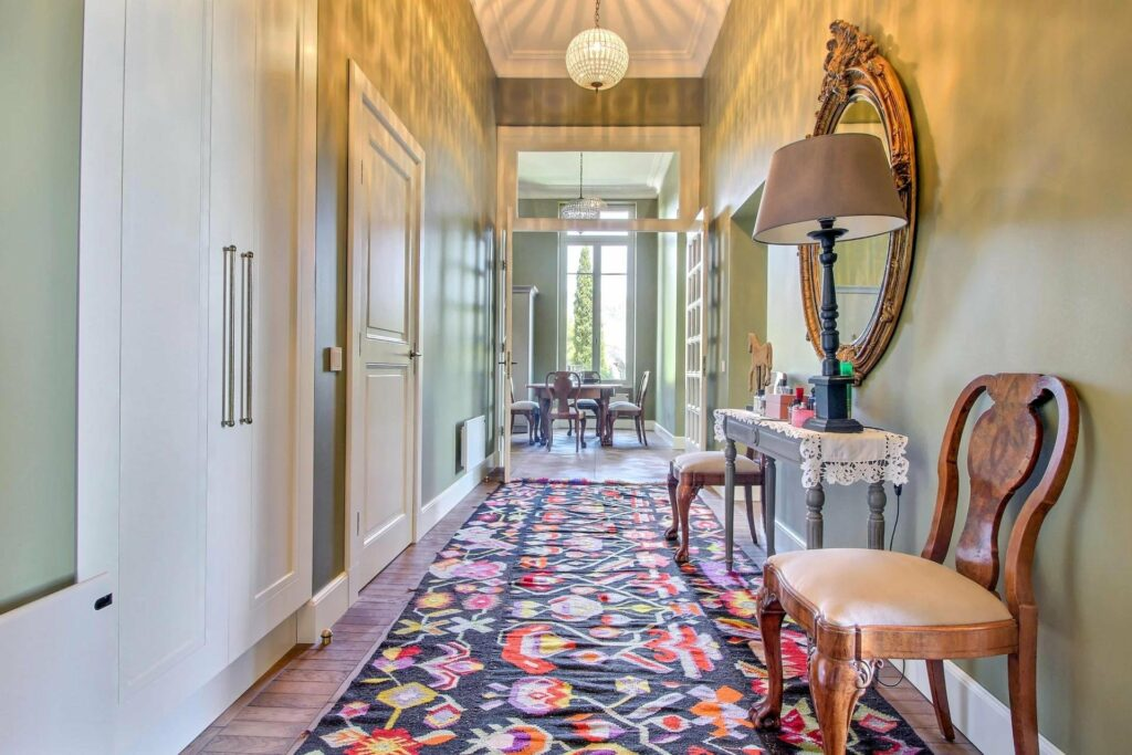 decorated hallways with colorful floral rug and classic french style
