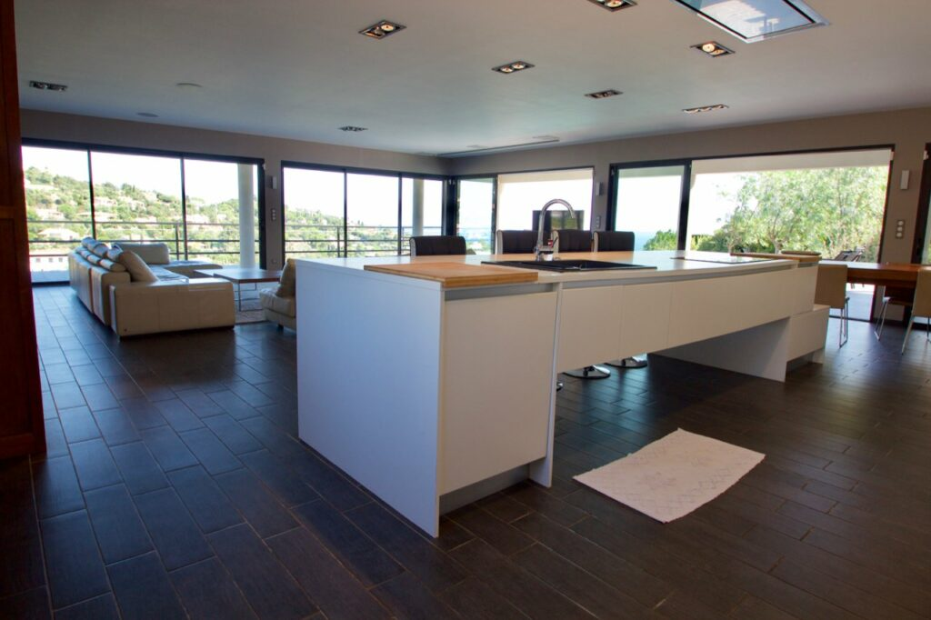 modern kitchen in private villa south france with white island