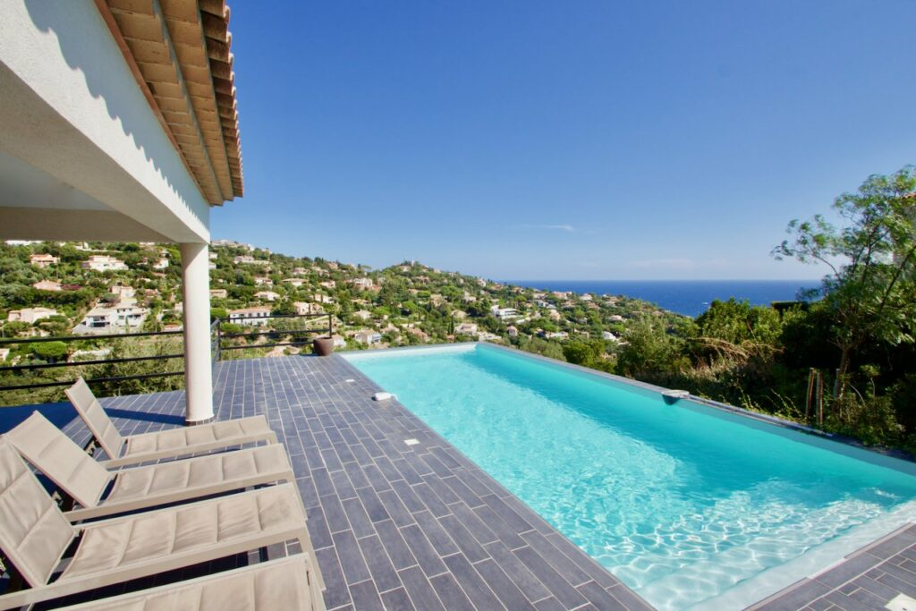 backyard of villa with infinity pool and view of moutains and mediterranean seasea